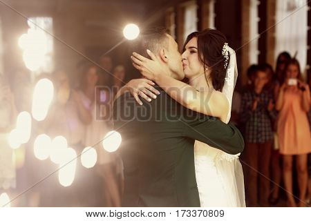 Romantic Newlywed Couple Kissing, Handsome Groom And Beautiful Happy Bride First Dance While Holding
