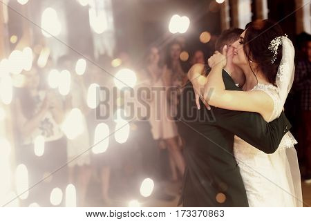 Happy Gorgeous Wedding Couple Having First Dance At Wedding Party In Restaurant Reception With Firew