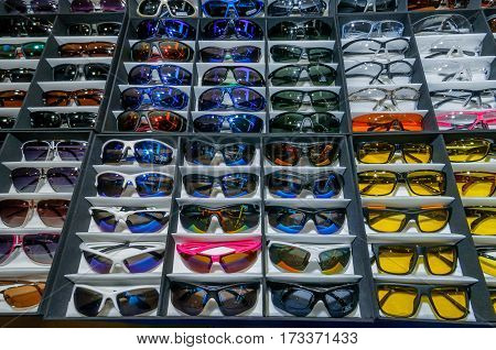 Moscow, Russia - February 25, 2017: Showcase with many tactical protective sunglasses for fashion background