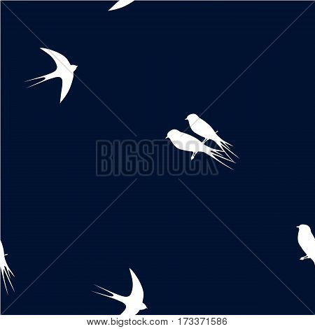 Seamless pattern with white swallow birds on a dark blue background. It can be used for packing of gifts, tiles fabrics backgrounds. Raster copy.