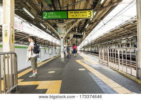 TOKYO JAPAN - OCTOBER 23: Japanese at Hamamatsucho station on Yamanote line on October 23 2016. Tokyo Japan. Tourists from Haneda airport can change train this station to Tokyo or another city in Japan.