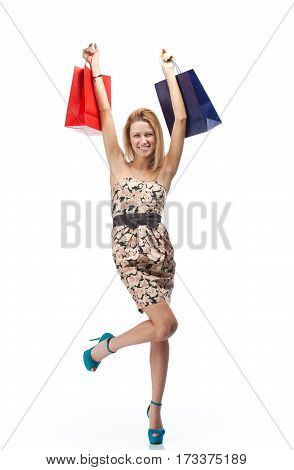 Young blonde woman with shopping bags. Isolated over white