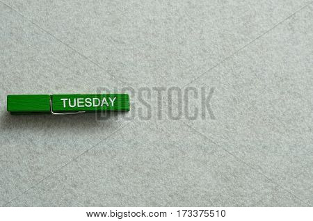 Tuesday written on a cloth peg isolated on a white background