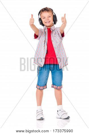 Full length portrait of happy teen boy with headphones, isolated on white background