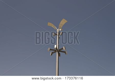 Silhouette of a street lamp at day