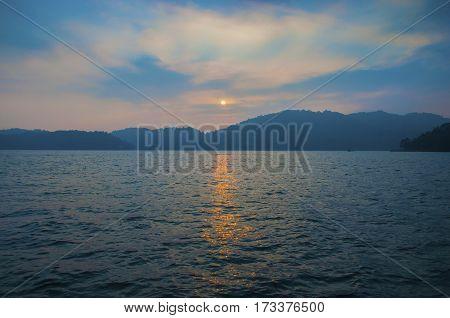 Sunset above mountain with reflex on water at Sun Moon Lake Taiwan
