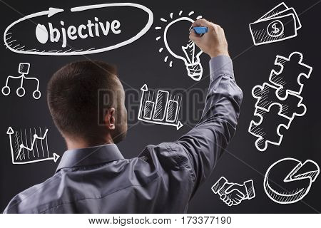 Technology, Internet, Business And Marketing. Young Business Man Writing Word: Objective