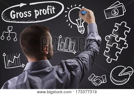Technology, Internet, Business And Marketing. Young Business Man Writing Word: Gross Profit