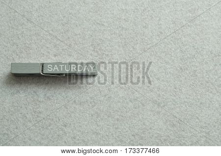 Saturday written on a cloth peg isolated on a white background
