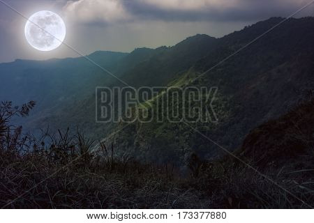 Mountain Peaks With Sky And Beautiful Full Moon. Sepia Color. Vintage Tone.