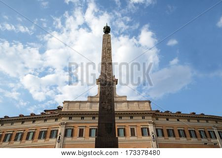 ROME, ITALY - SEPTEMBER 02: Palazzo Montecitorio, seat of the Italian Chamber of Deputies with the obelisk of Augustus in Rome, Italy on September 02, 2016.