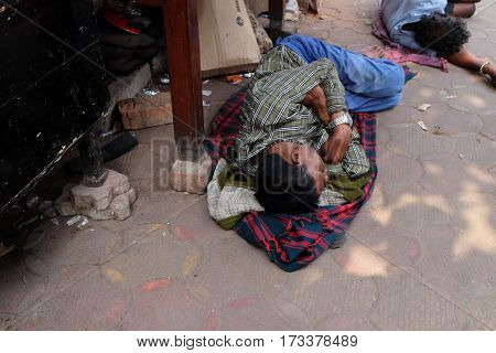 KOLKATA, INDIA - FEBRUARY 07: Homeless people sleeping on the footpath of Kolkata, India on February 07, 2016.