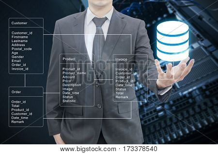 Double Exposure Of Professional Businessman Hold Database Table With Server Storage And Network In D