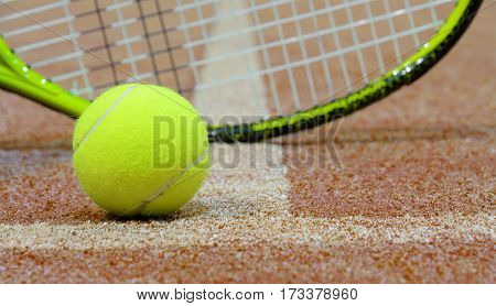 Tennis ball and racket on the court with copy space. Selective focus on tennis ball.
