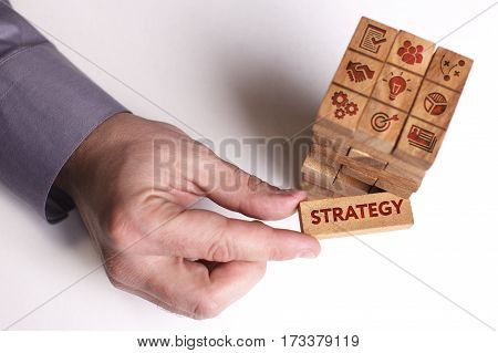 Business, Technology, Internet And Network Concept. Young Businessman Shows The Word: Strategy
