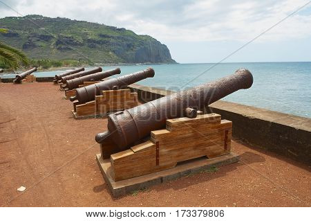 SAINT-DENIS DE LA REUNION, FRANCE - DECEMBER 07, 2010: Old cannons at the sea side of the Saint-Denis De La Reunion capital of the French overseas region and department of Reunion.