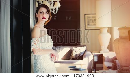 Beautiful Young Woman Standing Near The Door In The Light Luxury Room And Looking Somewhere