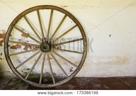 A whell of old wagon on the wall