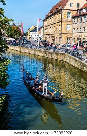 BAMBERG, GERMANY - Circa September, 2016: Gondolier rowing tourists on the River Regnitz in the area known as Little Venice, Bamberg, Germany
