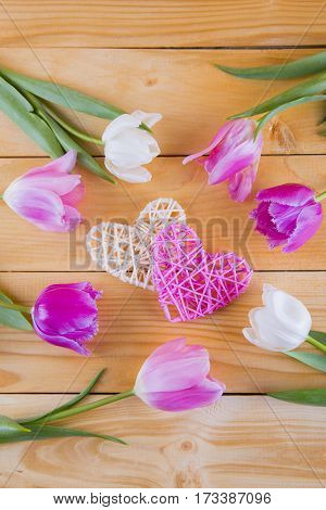 Bouquet Of Tender Pink Tulips With Wicker Hearts On Light Wooden Background