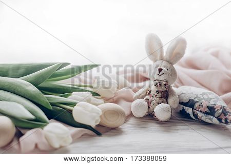 Stylish White Tulips Easter Eggs And Bunny On Rustic Wooden Background. Happy Easter Greeting Card C