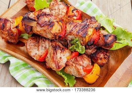 Grilled pork kebab with red and yellow pepper