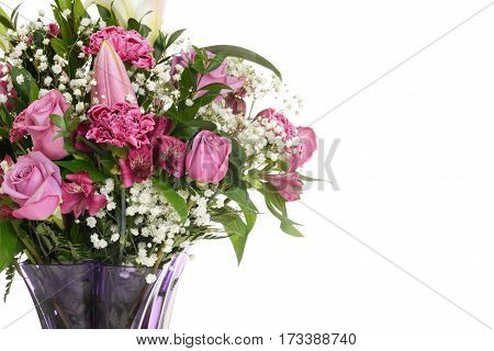 closeup bouquet pink roses with lilies and carnations