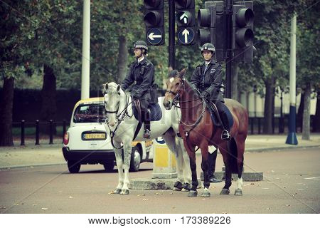 LONDON, UK - SEP 27: Policeman on horseback in street on September 27, 2013 in London, UK. London is the world's most visited city and the capital of UK.