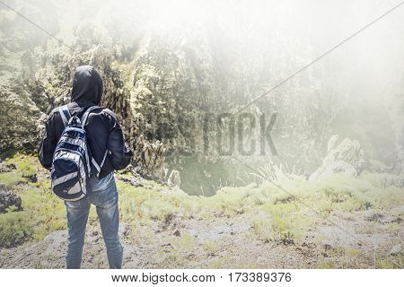 hiker man with backpack at enjoying mountains