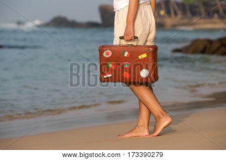 Beautiful Girl With A Old Vintage Suitcase In A Beach