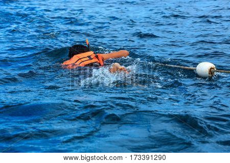 Snorkeling activity of tourist with life jacket Lipe Thailand