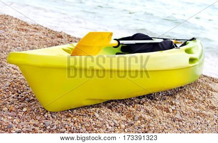 Yellow kayak on the beach in Crimea