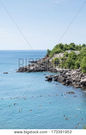 Blue Sea And Blue Sky With Rocky Beach