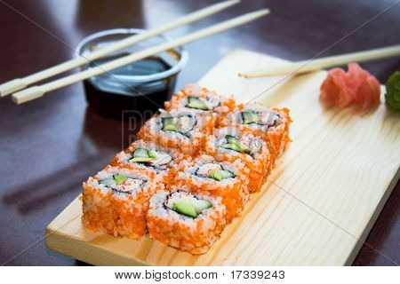 california sushi rolls with sauce on plate