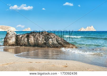 Sandy beach with stones on a foreground on Crete island, Greece