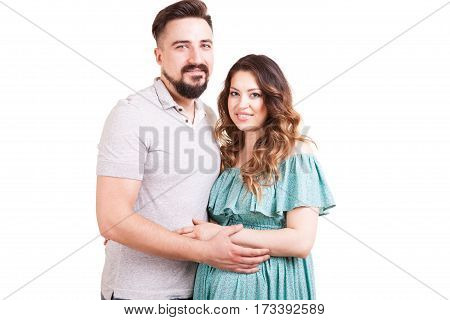 Happy Couple With Pregnant Woman Over White Background