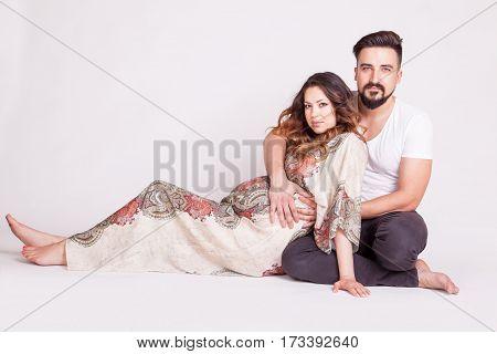 Pregnant Couple In Studio Photo