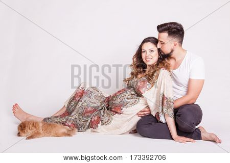 Loving Family With Pregnant Wife