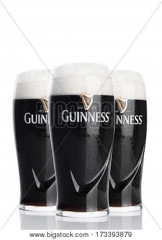 LONDON UK - FEBRUARY 26 2017: Glasses of Guinness original beer on white background. Guinness beer has been produced since 1759 in Dublin Ireland.