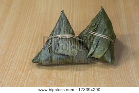 Chinese Cuisine Delicious Zongzi or Sticky Rice Dumpling in A Wooden Table