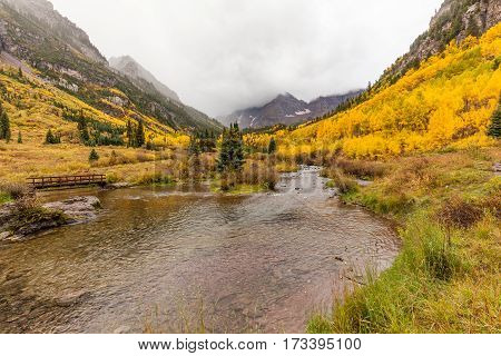 an autumn landscape on a stormy day at Maroon Bells Aspen Colorado
