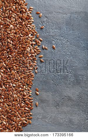 Brown Flax Seeds On Grey Wooden Table