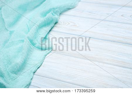 Mint Gauze Fabric On White Wooden Table