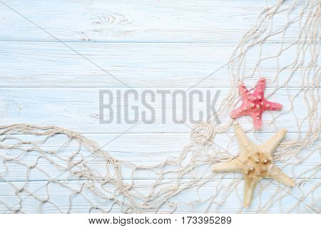 Fishing Net With Starfish On Wooden Table