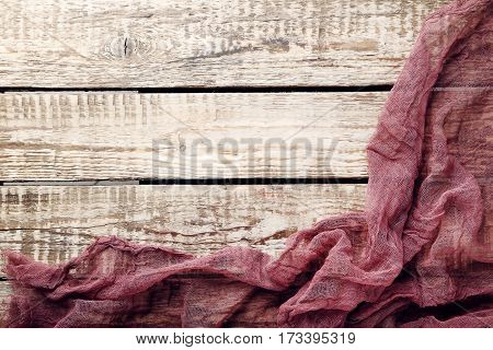 Burgundy Gauze Fabric On Brown Wooden Table