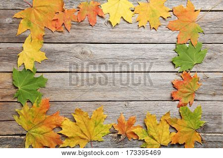 Autumn leafs on a grey wooden table