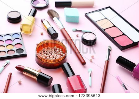 Different Makeup Cosmetics On A Pink Background