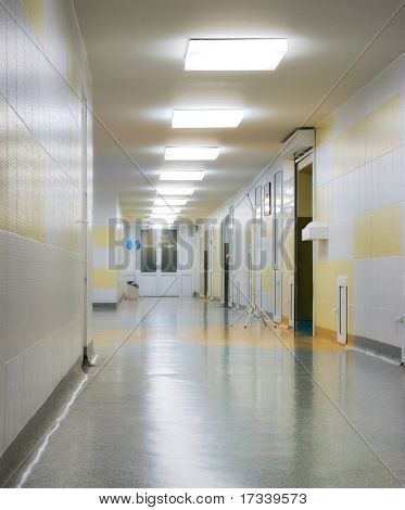 long corridor in hospital with lamps
