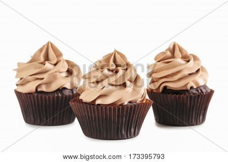 Tasty cupcakes isolated on a white background