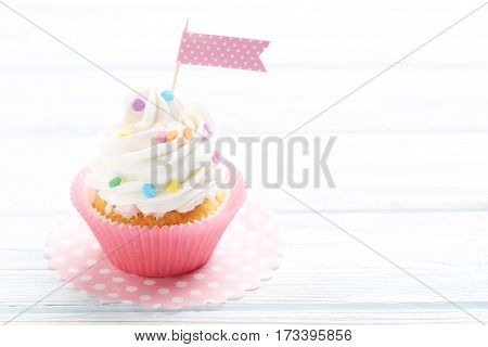Tasty Cupcake On A White Wooden Table